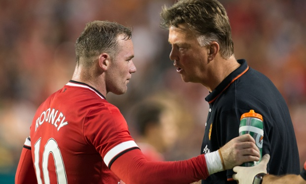 04 Aug 2014, Miami, Florida, USA --- Manchester United Head Coach Louis Van Gaal has a word with Captain Wayne Rooney (10) during Soccer, 2014 Guinness International Champions Cup Championship Match, between Manchester United and Liverpool on August 04, 2014 at Sun Life Stadium, Miami, FL, USA. Manchester United won the match with a score of 3-1. Photo © Ira L. Black --- Image by © Ira L. Black/Ira L. Black Photography/Corbis