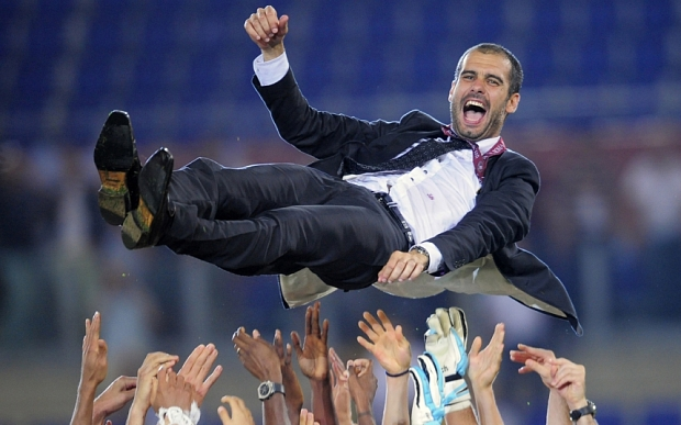 FILE - In this Wednesday May 27, 2009 file photo Barcelona coach Pep Guardiola is thrown in the air in celebration, at the end of the UEFA Champions League final soccer match between Manchester United and Barcelona in Rome. Pep Guardiola will not continue as Barcelona's coach after this season, according to Spanish news reports. Guardiola, whose contract expires at the end of the season, is scheduled to announce his decision on Friday in a news conference at 1330 local time (1130 GMT) with club president Sandro Rosell and sports director Andoni Zubizarreta. (AP Photo/Manu Fernandez, File)